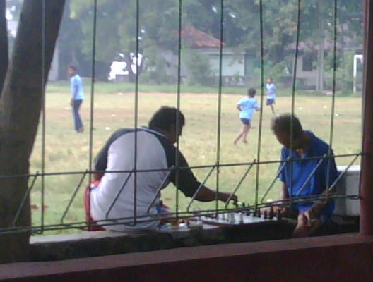 PE teacher smoking and playing chess during a lesson 2011